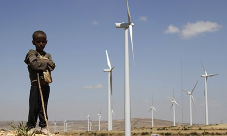 MDG : A boy stands in front of turbines at the Ashegoda wind farm, Ethiopia