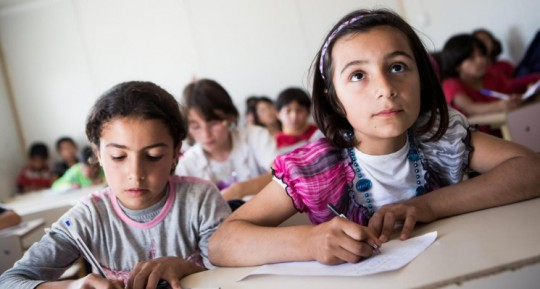 CROP-Iraq-May-2013.-Ten-year-old-Syrian-refugee-Ahin-right-following-the-lesson-among-other-pupils-in-the-KAR-school-in-the-Domiz-refugee-camp-in-Northern-Iraq.-©-UNICEF-UKLA2012-00993-KARIN-SCHERMBRUCKER-745x400